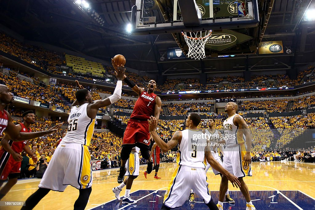 <a gi-track='captionPersonalityLinkClicked' href=/galleries/search?phrase=Chris+Bosh&family=editorial&specificpeople=201574 ng-click='$event.stopPropagation()'>Chris Bosh</a> #1 of the Miami Heat shoots the ball against <a gi-track='captionPersonalityLinkClicked' href=/galleries/search?phrase=Roy+Hibbert&family=editorial&specificpeople=725128 ng-click='$event.stopPropagation()'>Roy Hibbert</a> #55 and George Hill #3 of the Indiana Pacers in Game Six of the Eastern Conference Finals during the 2013 NBA Playoffs at Bankers Life Fieldhouse on June 1, 2013 in Indianapolis, Indiana.