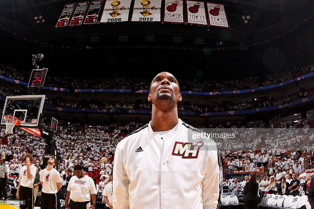Chris Bosh #1 of the Miami Heat, standing under the team's Championship banners, listens to the National Anthem before playing against the Miami Heat in Game Five of the Eastern Conference Semifinals during the 2013 NBA Playoffs on May 15, 2013 at American Airlines Arena in Miami, Florida.