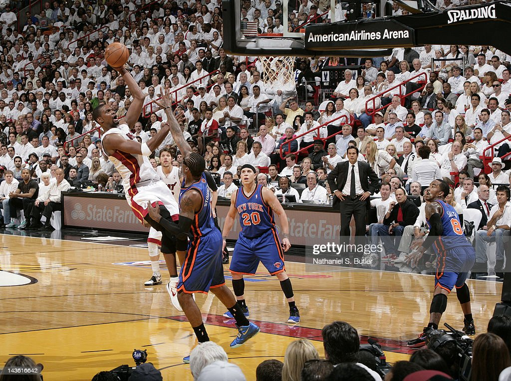 <a gi-track='captionPersonalityLinkClicked' href=/galleries/search?phrase=Chris+Bosh&family=editorial&specificpeople=201574 ng-click='$event.stopPropagation()'>Chris Bosh</a> #1 of the Miami Heat takes a jump shot over Amare Stoudemire #1 of the New York Knicks in Game Two of the Eastern Conference Quarterfinals during the 2012 NBA Playoffs on April 30, 2012 at American Airlines Arena in Miami, Florida.