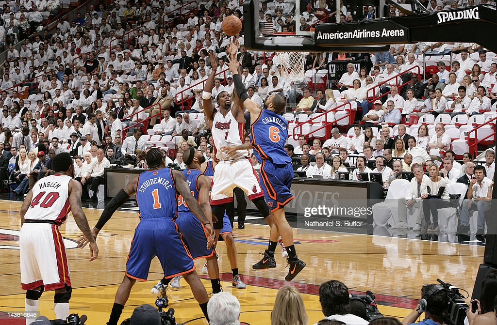 <a gi-track='captionPersonalityLinkClicked' href=/galleries/search?phrase=Chris+Bosh&family=editorial&specificpeople=201574 ng-click='$event.stopPropagation()'>Chris Bosh</a> #1 of the Miami Heat takes a jump shot over <a gi-track='captionPersonalityLinkClicked' href=/galleries/search?phrase=Tyson+Chandler&family=editorial&specificpeople=202061 ng-click='$event.stopPropagation()'>Tyson Chandler</a> #6 of the New York Knicks in Game Two of the Eastern Conference Quarterfinals during the 2012 NBA Playoffs on April 30, 2012 at American Airlines Arena in Miami, Florida.