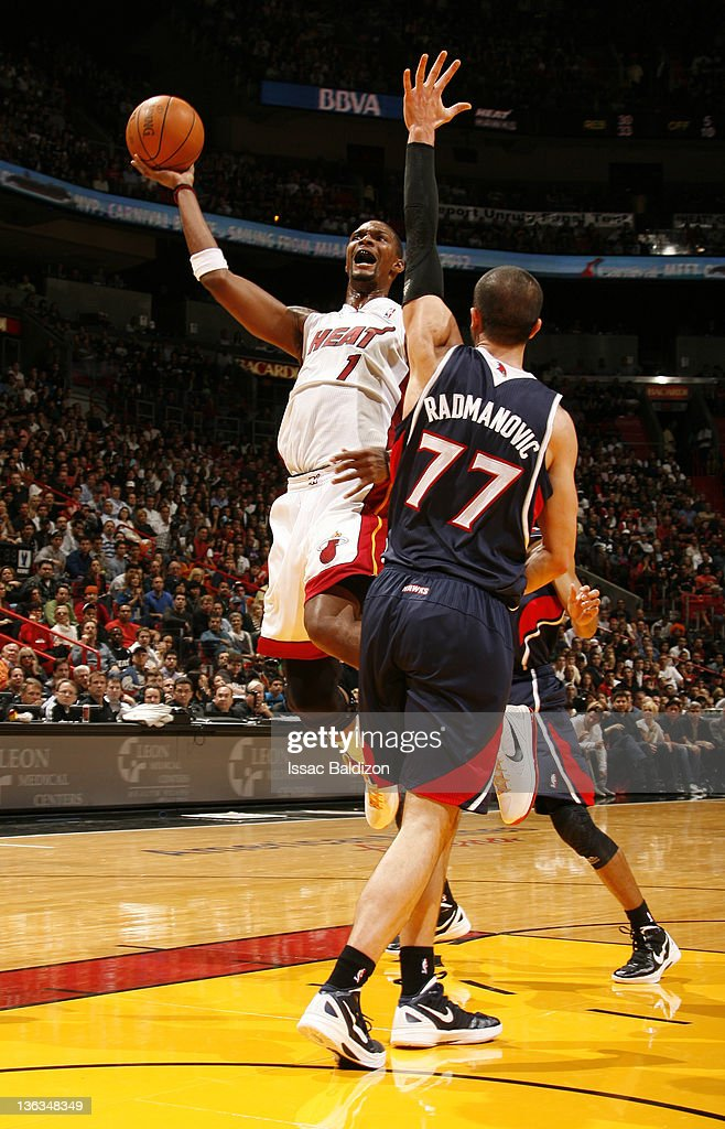 <a gi-track='captionPersonalityLinkClicked' href=/galleries/search?phrase=Chris+Bosh&family=editorial&specificpeople=201574 ng-click='$event.stopPropagation()'>Chris Bosh</a> #1 of the Miami Heat takes a jump shot over <a gi-track='captionPersonalityLinkClicked' href=/galleries/search?phrase=Vladimir+Radmanovic&family=editorial&specificpeople=201834 ng-click='$event.stopPropagation()'>Vladimir Radmanovic</a> #77 of the Atlanta Hawks during the fourth quarter on January 2, 2012 at American Airlines Arena in Miami, Florida.