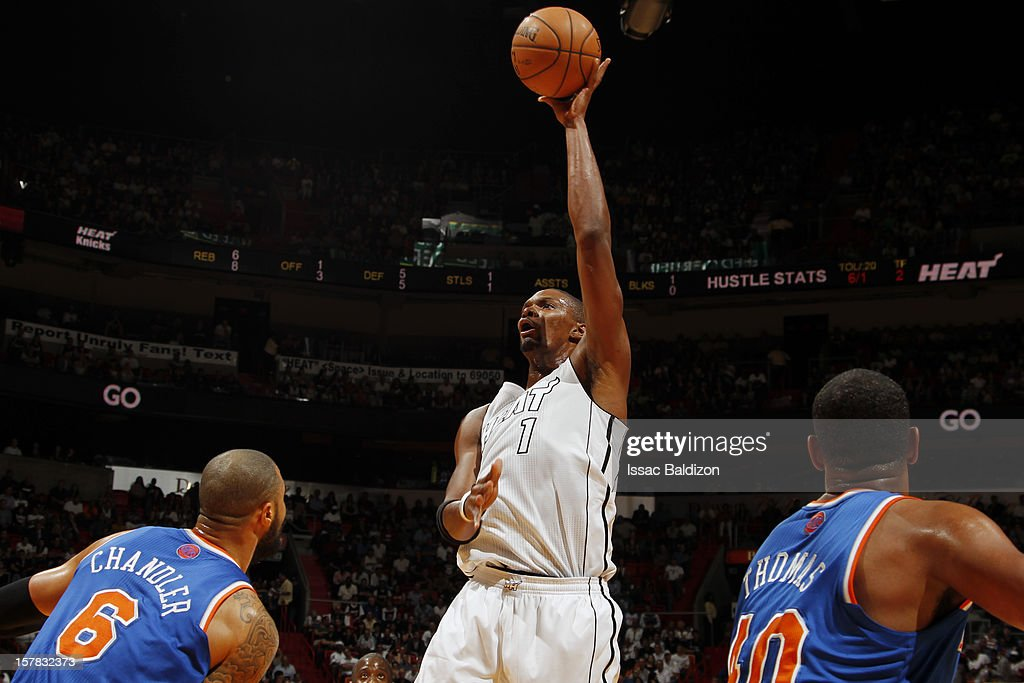 Chris Bosh #1 of the Miami Heat takes a short shot againt the New York Knicks during a game on December 6, 2012 at American Airlines Arena in Miami, Florida.