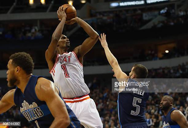 Chris Bosh of the Miami Heat takes a shot against JJ Barea of the Dallas Mavericks in the first half at American Airlines Center on February 3 2016...