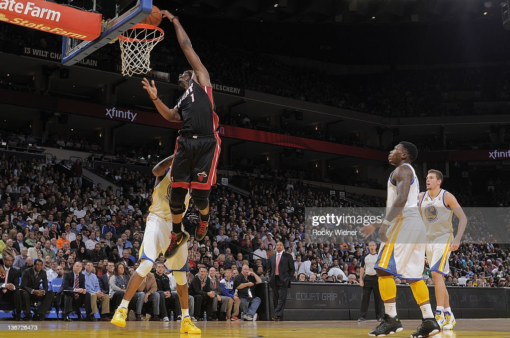 Chris Bosh #1 of the Miami Heat throws down a dunk over Dorell Wright #1 of the Golden State Warriors on January 10, 2012 at Oracle Arena in Oakland, California.