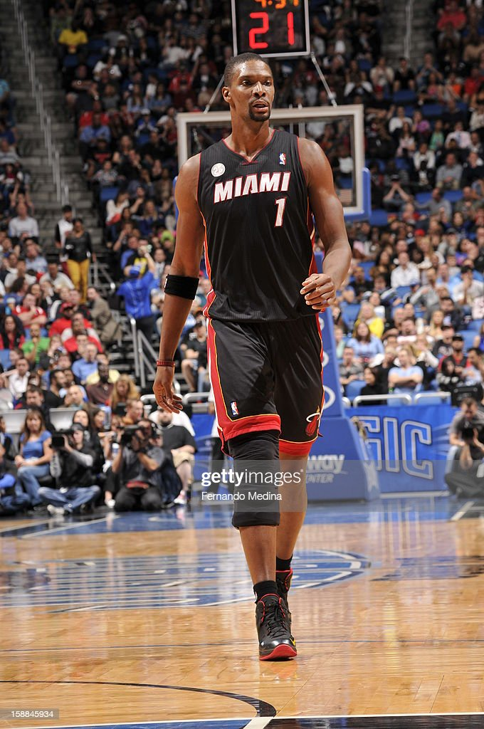 Chris Bosh #1 of the Miami Heat walks back after a break in the action against the Orlando Magic during the game on December 31, 2012 at Amway Center in Orlando, Florida.