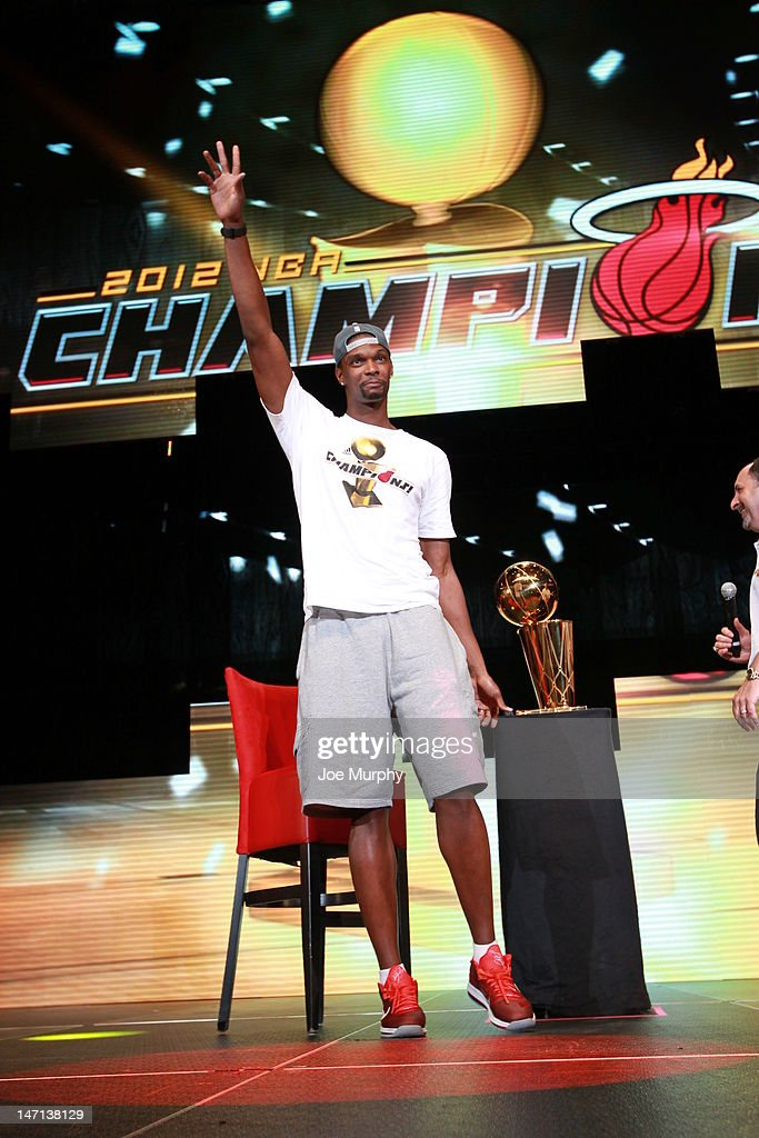 Chris Bosh #1 of the Miami Heat waves to the crowd during a rally for the 2012 NBA Champions Miami Heat on June 25, 2012 at American Airlines Arena in Miami, Florida.