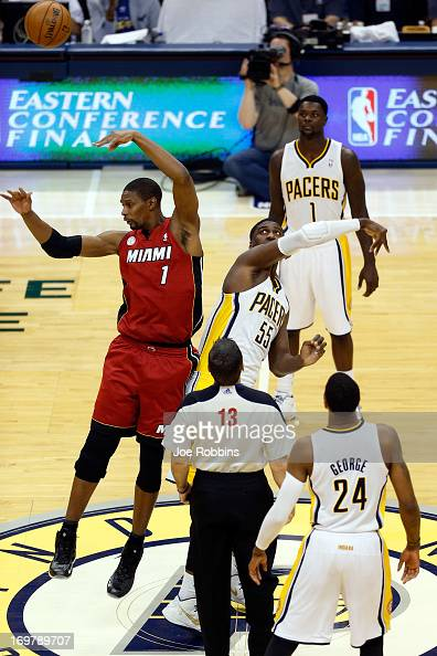 Chris Bosh of the Miami Heat wins the faceoff against Roy Hibbert of the Indiana Pacers to start Game Six of the Eastern Conference Finals during the...