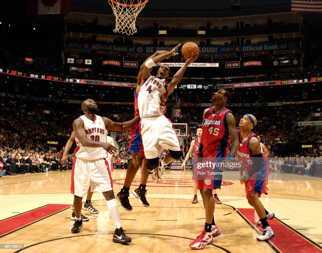 Chris Bosh of the Toronto Raptors drives hard through the lane next to Rasual Butler of the Los Angeles Clippers during a game on March 31 2010 at...