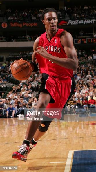 Chris Bosh of the Toronto Raptors drives to the basket against the Dallas Mavericks on November 20 2007 at the American Airlines Center in Dallas...