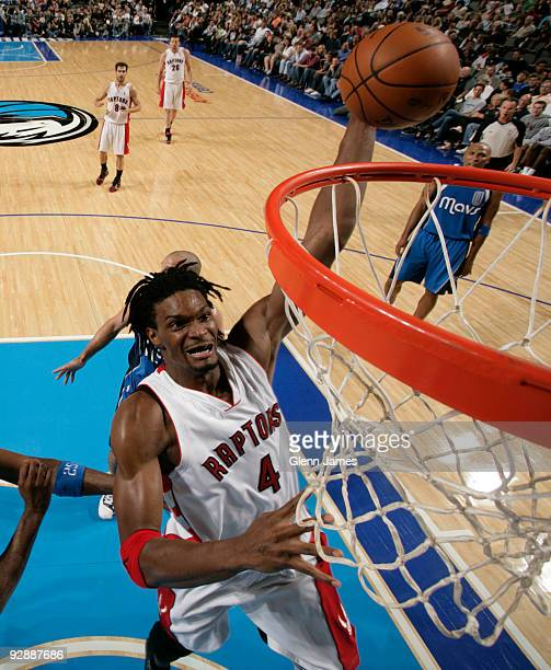 Chris Bosh of the Toronto Raptors goes up for the dunk against the Dallas Mavericks during a game at the American Airlines Center on November 7 2009...