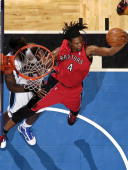 Chris Bosh of the Toronto Raptors grabs a rebound against the Orlando Magic during the game on January 6 2010 at Amway Arena in Orlando Florida NOTE...