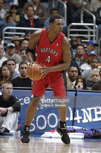 Chris Bosh of the Toronto Raptors looks to move the ball against the Los Angeles Clippers on November 23 2005 at Staples Center in Los Angeles...