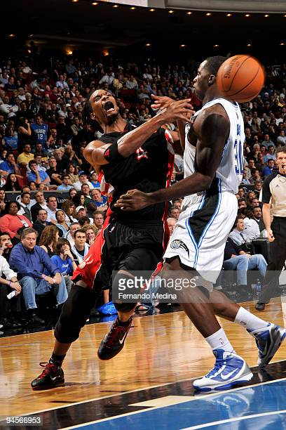 Chris Bosh of the Toronto Raptors passes against Brandon Bass of the Orlando Magic on December 16 2009 at Amway Arena in Orlando Florida NOTE TO USER...