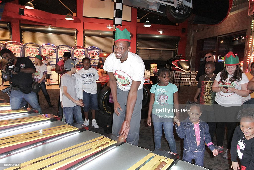 <a gi-track='captionPersonalityLinkClicked' href=/galleries/search?phrase=Chris+Bosh&family=editorial&specificpeople=201574 ng-click='$event.stopPropagation()'>Chris Bosh</a> playing games with the children during the Christmas With <a gi-track='captionPersonalityLinkClicked' href=/galleries/search?phrase=Chris+Bosh&family=editorial&specificpeople=201574 ng-click='$event.stopPropagation()'>Chris Bosh</a> At 'Santa Bosh's Workshop at Game Time at Sunset Place on December 17, 2012 in Miami, Florida.