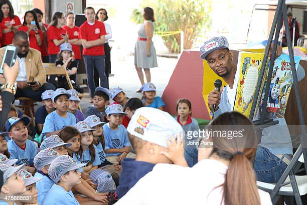 Chris Bosh reads a book to the children from Boys Girls Club during the Day Out With Thomas The Thrill of the ride tour 2014 off at The Gold Coast...