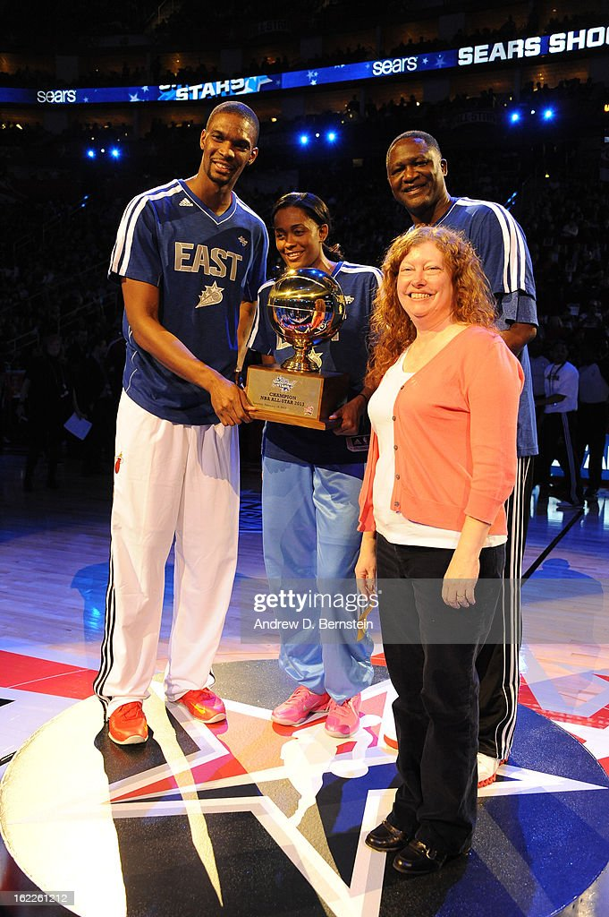 Chris Bosh, Swin Cash and Dominique Wilkins are present with the trophy by Becky Lambert of Sears after winning the 2013 Sears Shooting Stars Competition on State Farm All-Star Saturday Night as part of 2013 NBA All-Star Weekend on February 16, 2013 at Toyota Center in Houston, Texas.