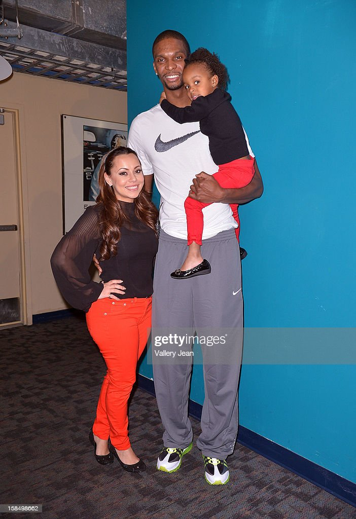 Chris Bosh, wife Adrienne Bosh and daughter Trinity attend the 'Santa Bosh's Workshop' Celebration at Game Time at Sunset Place on December 17, 2012 in Aventura, Florida.
