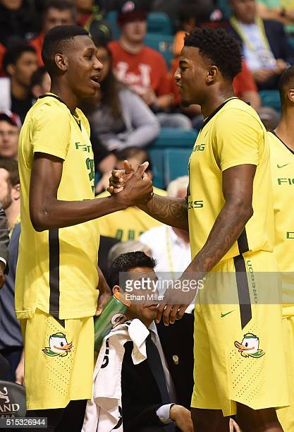 Chris Boucher of the Oregon Ducks greets teammate Jordan Bell as he comes out of the game late in the team's 8857 victory over the Utah Utes to win...