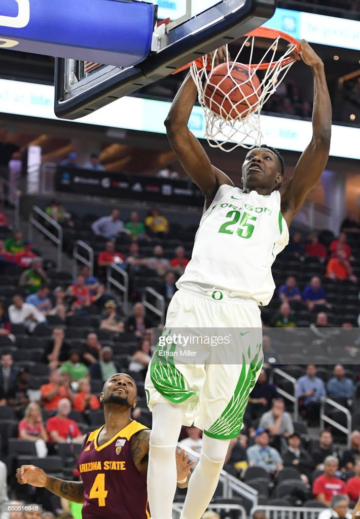 Chris Boucher #25 of the Oregon Ducks dunks ahead of Torian Graham #4 of the Arizona State Sun Devils during a quarterfinal game of the Pac-12 Basketball Tournament at T-Mobile Arena on March 9, 2017 in Las Vegas, Nevada.