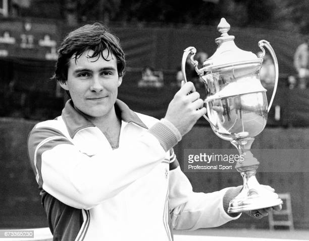 Chris Bradnam of Great Britain holding the trophy following his victory in a Men's Singles tennis match circa 1977