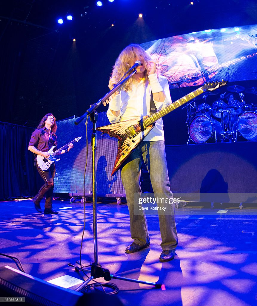 Chris Broderick(L) and Dave Mustaine(R) of Megadeth performs at The Wellmont Theatre on November 29, 2013 in Montclair, New Jersey.