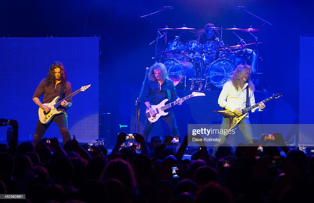 Chris Broderick(L), David Ellefson(C) and Dave Mustaine(R) of Megadeth performs at The Wellmont Theatre on November 29, 2013 in Montclair, New Jersey.