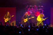 Chris Broderick David Ellefson and Dave Mustaine of Megadeth performs at The Wellmont Theatre on November 29 2013 in Montclair New Jersey