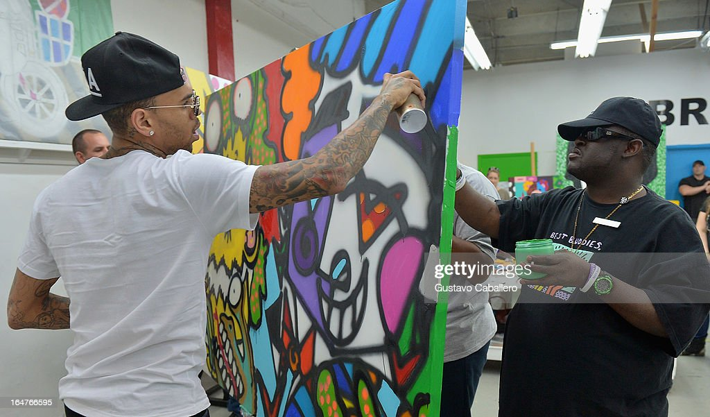 Chris Brown and Dimitrius Dozier attend the Chris Brown joins forces with artist Romero Britto in support of Best Buddies International event on March 27, 2013 in Miami, Florida.