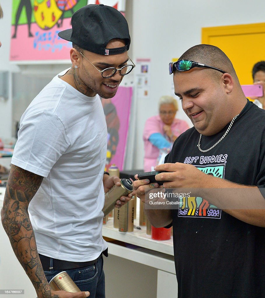 Chris Brown and Gino Carfagna attend the Chris Brown joins forces with artist Romero Britto in support of Best Buddies International event on March 27, 2013 in Miami, Florida.