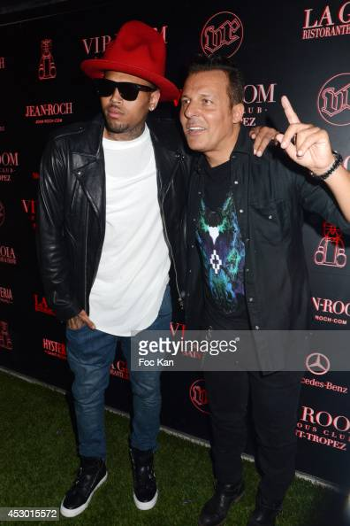 Chris Brown and Jean Roch Pedri attend the Chris Brown Concert Party VIP Room Saint Tropez July 31 2014 in Saint Tropez France