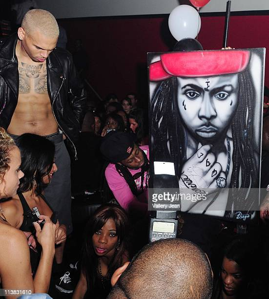chris Brown and Lil Wayne attend Chris Brown's 22nd birthday party at Club Play on May 6 2011 in Miami Beach Florida