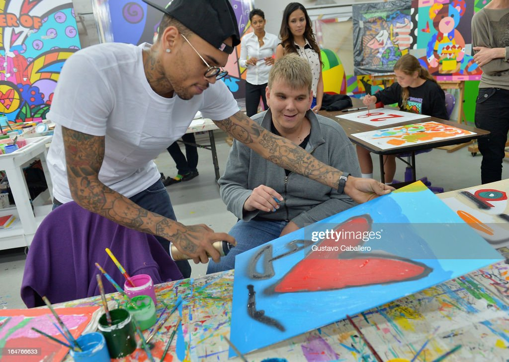 Chris Brown and Nick Crook attend the Chris Brown joins forces with artist Romero Britto in support of Best Buddies International event on March 27, 2013 in Miami, Florida.
