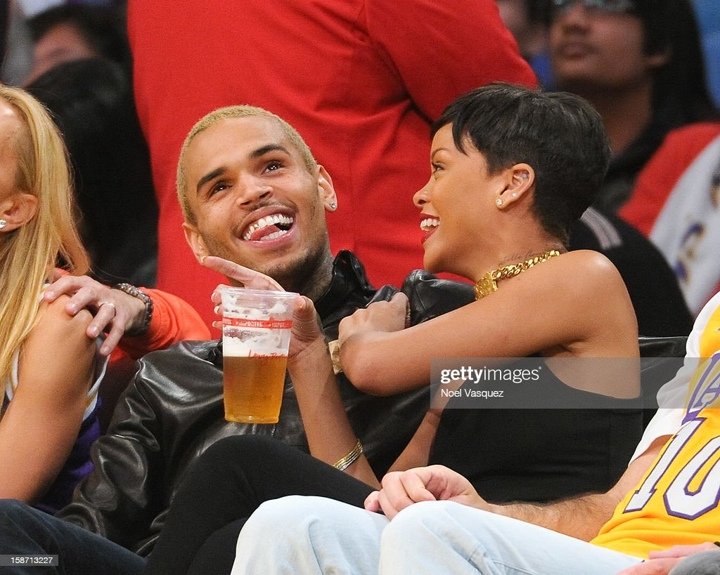 Chris Brown (L) and Rihanna attend a basketball game between the New York Knicks and the Los Angeles Lakers at Staples Center on December 25, 2012 in Los Angeles, California.