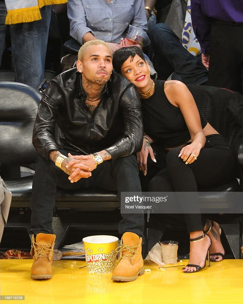 Chris Brown (L) and <a gi-track='captionPersonalityLinkClicked' href=/galleries/search?phrase=Rihanna&family=editorial&specificpeople=453439 ng-click='$event.stopPropagation()'>Rihanna</a> attend a basketball game between the New York Knicks and the Los Angeles Lakers at Staples Center on December 25, 2012 in Los Angeles, California.