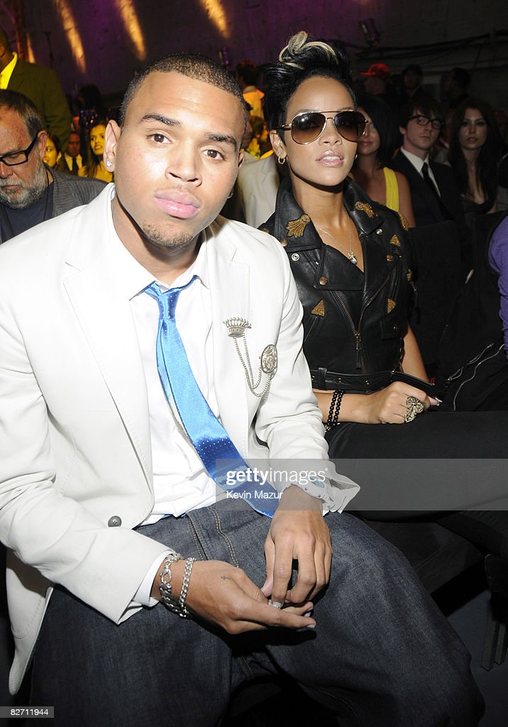 Chris Brown and <a gi-track='captionPersonalityLinkClicked' href=/galleries/search?phrase=Rihanna&family=editorial&specificpeople=453439 ng-click='$event.stopPropagation()'>Rihanna</a> in the audience at the 2008 MTV Video Music Awards at Paramount Pictures Studios on September 7, 2008 in Los Angeles, California.