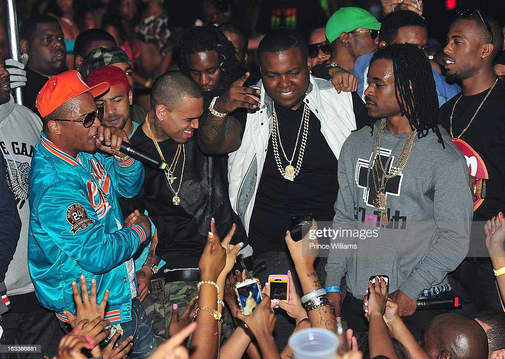 <a gi-track='captionPersonalityLinkClicked' href=/galleries/search?phrase=T.I.&family=editorial&specificpeople=221599 ng-click='$event.stopPropagation()'>T.I.</a>, Chris Brown and <a gi-track='captionPersonalityLinkClicked' href=/galleries/search?phrase=Sean+Kingston&family=editorial&specificpeople=4413979 ng-click='$event.stopPropagation()'>Sean Kingston</a> on stage at a party hosted by <a gi-track='captionPersonalityLinkClicked' href=/galleries/search?phrase=T.I.&family=editorial&specificpeople=221599 ng-click='$event.stopPropagation()'>T.I.</a> and Fabolous at Cameo Nightclub on March 1, 2013 in Charlotte, North Carolina.