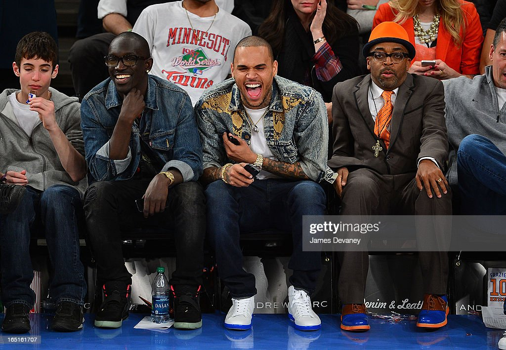 Chris Brown and <a gi-track='captionPersonalityLinkClicked' href=/galleries/search?phrase=Spike+Lee&family=editorial&specificpeople=156419 ng-click='$event.stopPropagation()'>Spike Lee</a> attend the Boston Celtics vs New York Knicks game at Madison Square Garden on March 31, 2013 in New York City.