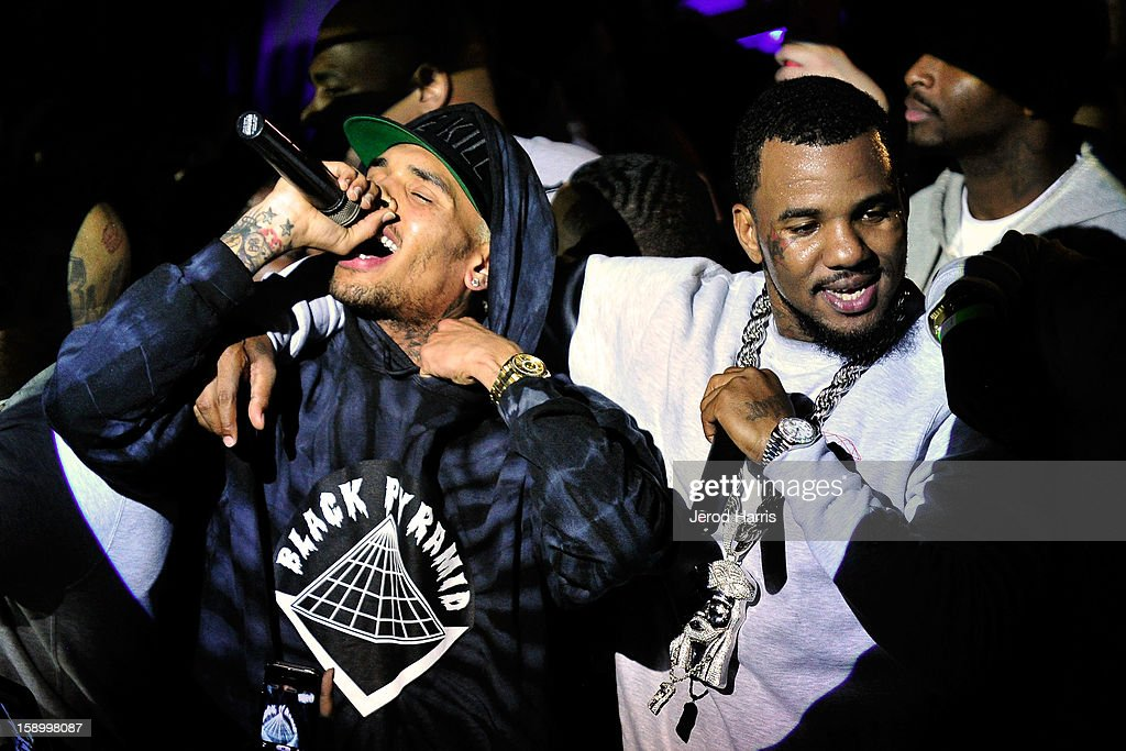 Chris Brown and <a gi-track='captionPersonalityLinkClicked' href=/galleries/search?phrase=The+Game+-+Hip+Hop+Artist&family=editorial&specificpeople=2239621 ng-click='$event.stopPropagation()'>The Game</a> perform at the DGK Agenda after party at Cafe Sevilla on January 4, 2013 in Long Beach, California.