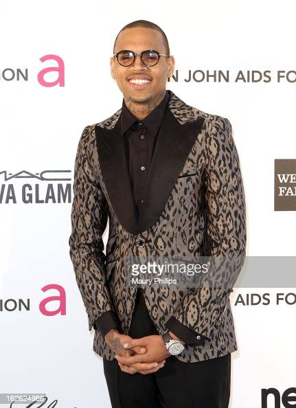 Chris Brown arrives at the 21st Annual Elton John AIDS Foundation Academy Awards Viewing Party at Pacific Design Center on February 24 2013 in West...