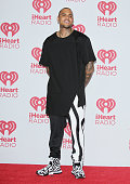 Chris Brown attends the iHeart Radio Music Festival press room held at MGM Grand Resort and Casino on September 19 2014 in Las Vegas Nevada
