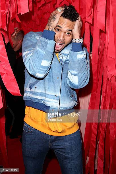 Chris Brown attends the L'Oreal Red Obsession Party Photocall as part of the Paris Fashion Week Womenswear Fall/Winter 2016/2017 on March 8 2016 in...