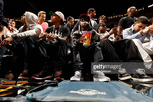 Chris Brown Bow Wow Lil Wayne a friend and Drake watch the Miami Heat play against the Boston Celtics on November 11 2010 at American Airlines Arena...