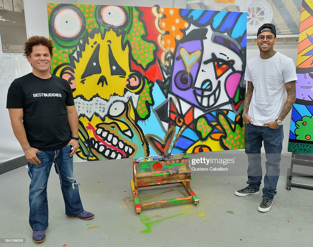 Chris Brown (R) joins forces with artist Romero Britto in support of Best Buddies International on March 27, 2013 in Miami, Florida.