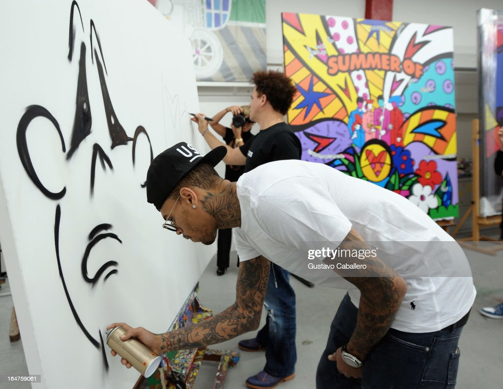 Chris Brown joins forces with artist Romero Britto in support of Best Buddies International on March 27, 2013 in Miami, Florida.