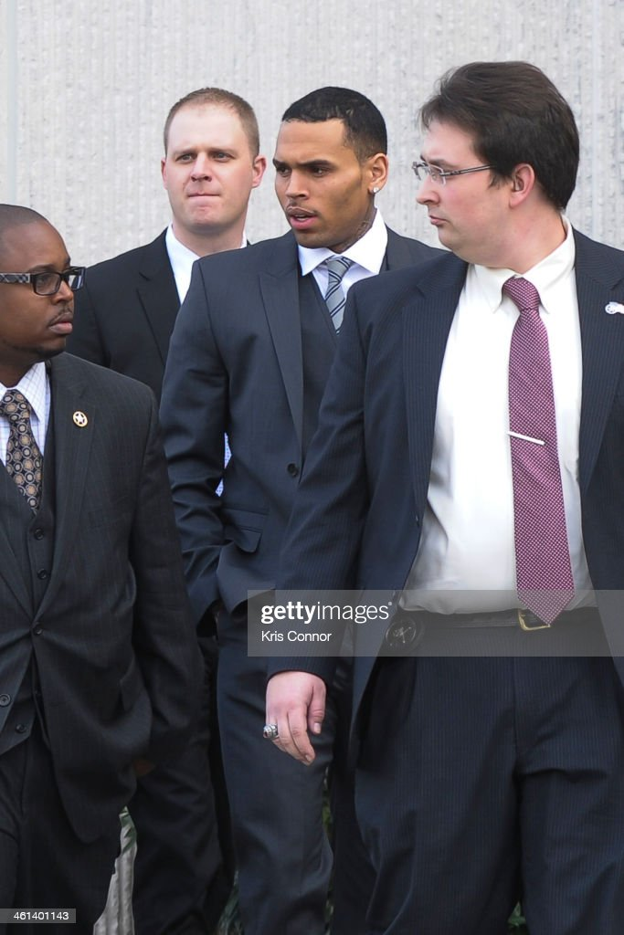 <a gi-track='captionPersonalityLinkClicked' href=/galleries/search?phrase=Chris+Brown+-+Singer&family=editorial&specificpeople=4452016 ng-click='$event.stopPropagation()'>Chris Brown</a> (C) leaves court where his attorneys rejected a plea deal that would have found him and his bodyguard guilty of simple assault on January 8, 2014 in Washington, DC. Brown faces a misdemeanor assault charge for allegedly punching a man in the face in October 2013.