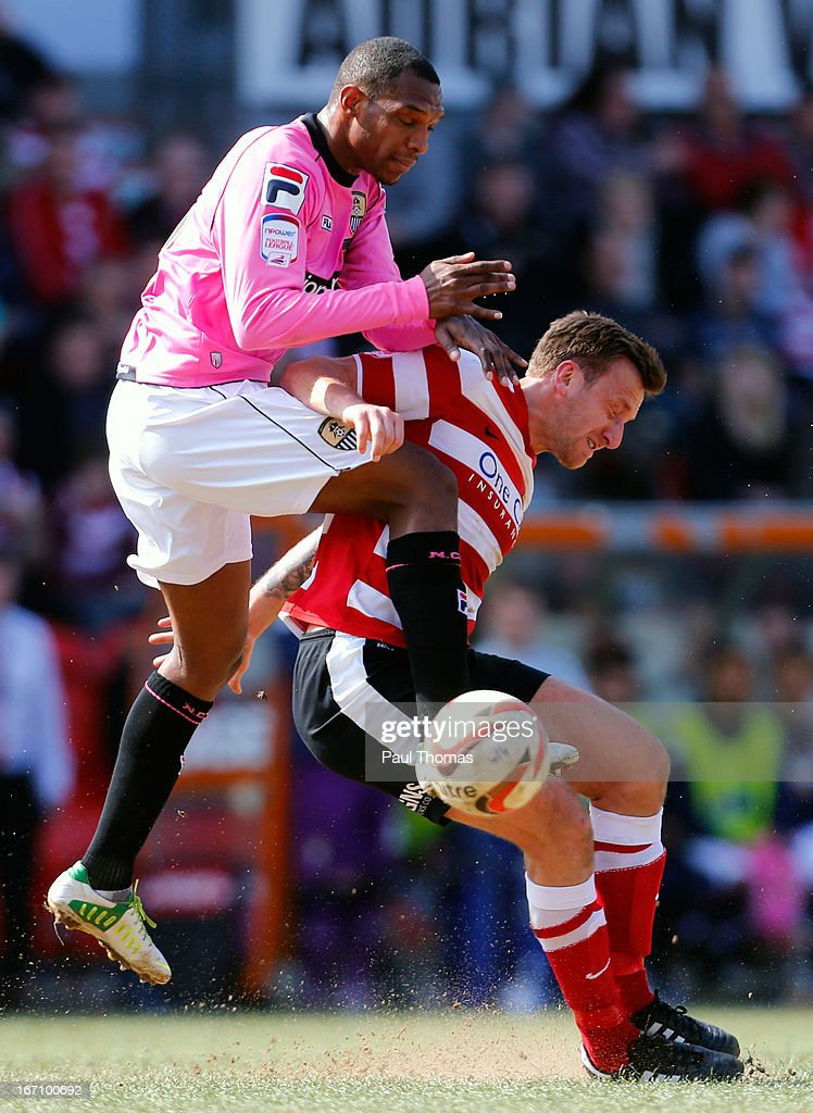 Chris Brown (R) of Doncaster in action with Krystian Pearce of Notts County during the npower League One match between Doncaster Rovers and Notts County at the Keepmoat Stadium on April 20, 2013 in Doncaster, England.