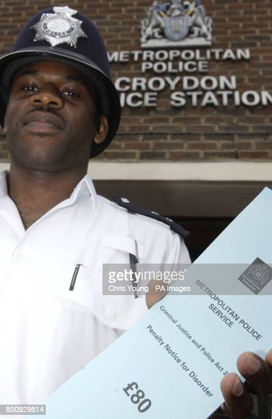 PC Chris Brown of the Metropolitan Police displays a new 'onthespot fine' ticket which has been introduced in Croydon south London Essex as a Home...