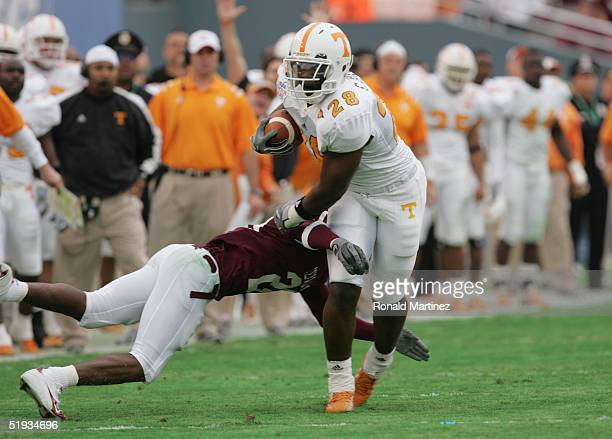 Chris Brown of the Tennessee Volunteers carries the ball against Broderick Newton of the Texas AM Aggies during the SBC Cotton Bowl game on January 1...