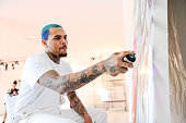 Chris Brown paints at SPACEBY3 during Fine Art Auctions Miami's Urban Art Week on February 12 2015 in Miami Florida