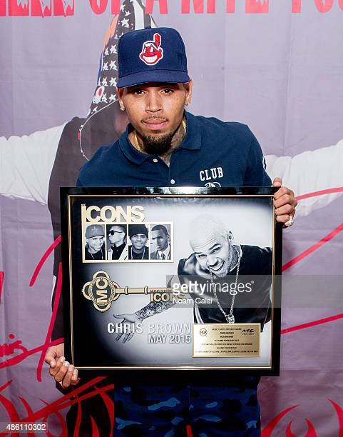 Chris Brown poses with a commemorative plaque celebrating him being named an MC Icon and being the top artist of all time on Music Choice On Demand...